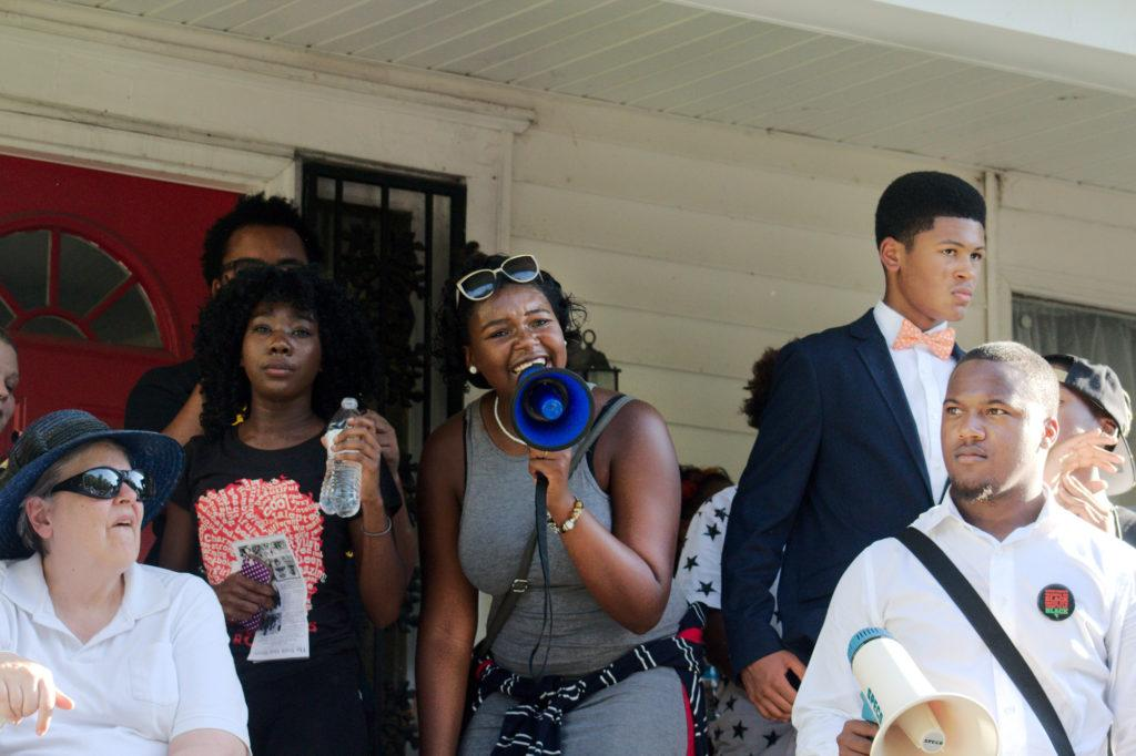 Manual BSU student Kyra Welch rallies the group of supporters who are attending the Black Lives Matter vigil on West Broadway Sunday, Jul. 10, 2016. Photo by: Robbie Spencer