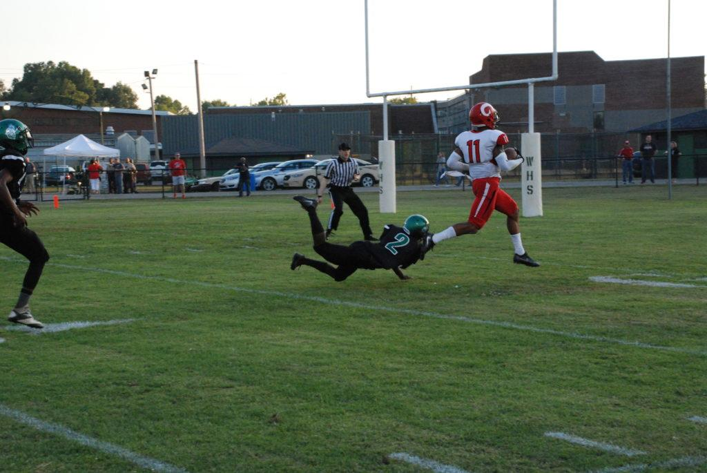 Jaelin Carter (11, 12)  running the ball into the end zone with the first touchdown of the night.