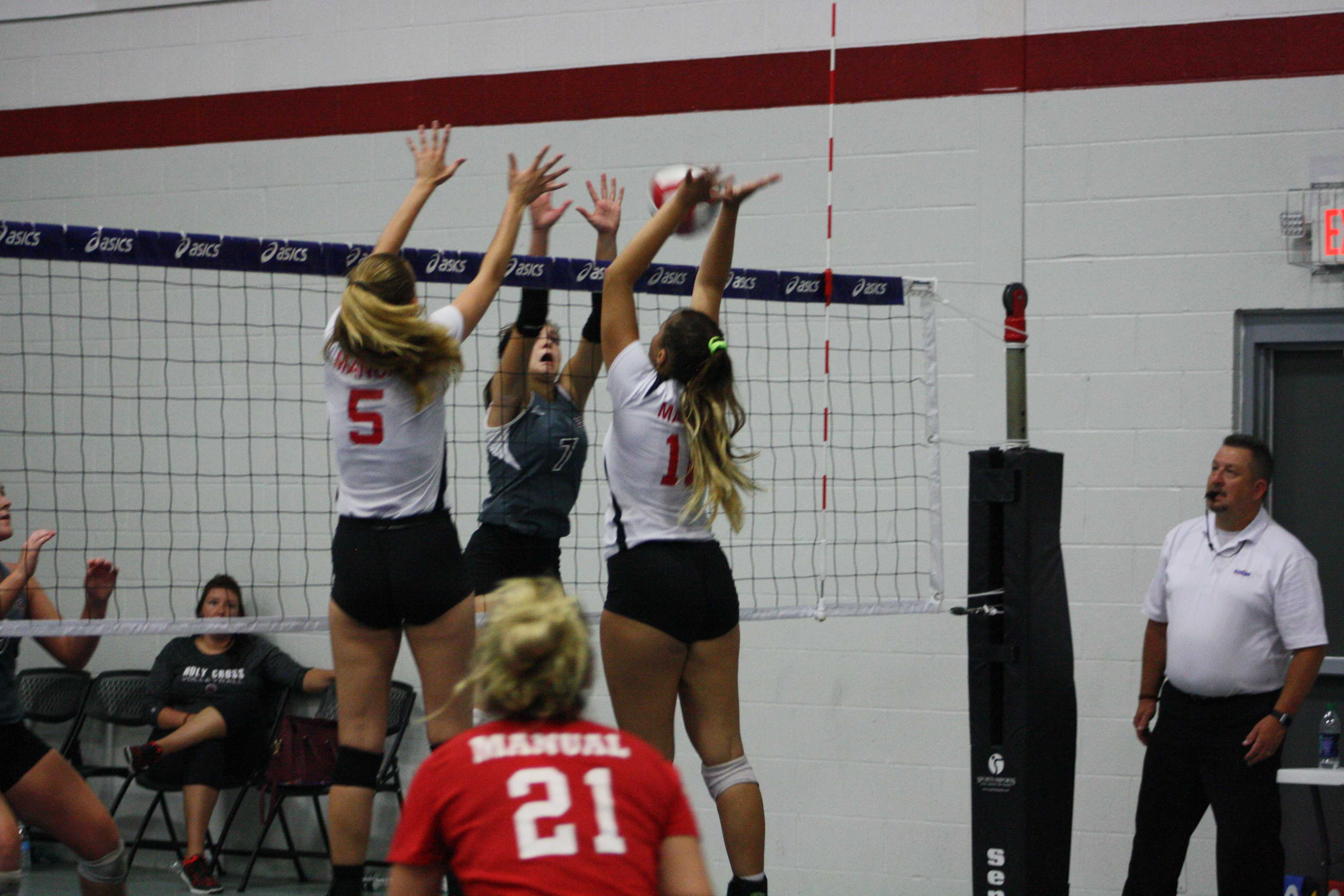 Manual looks to block the ball. Photo courtesy of Phoebe Monsour.
