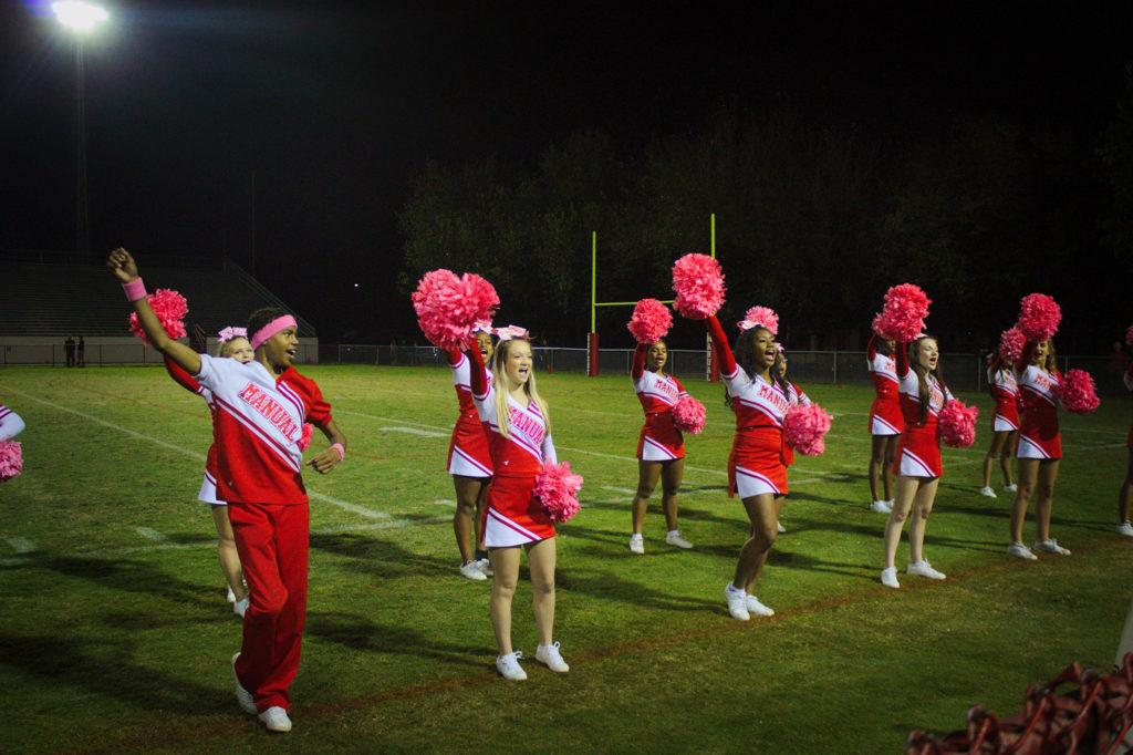 During+the+pink+out+game+the+cheerleaders+sported+pink+pom-poms+to+show+their+support.+Photo+by+Cicada+Hoyt.