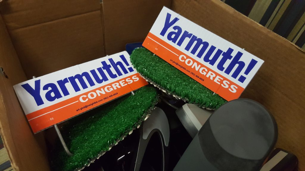 Yarmuth sign models are kept in box before Yarmuth speaks. Photo by Phoebe Monsour.