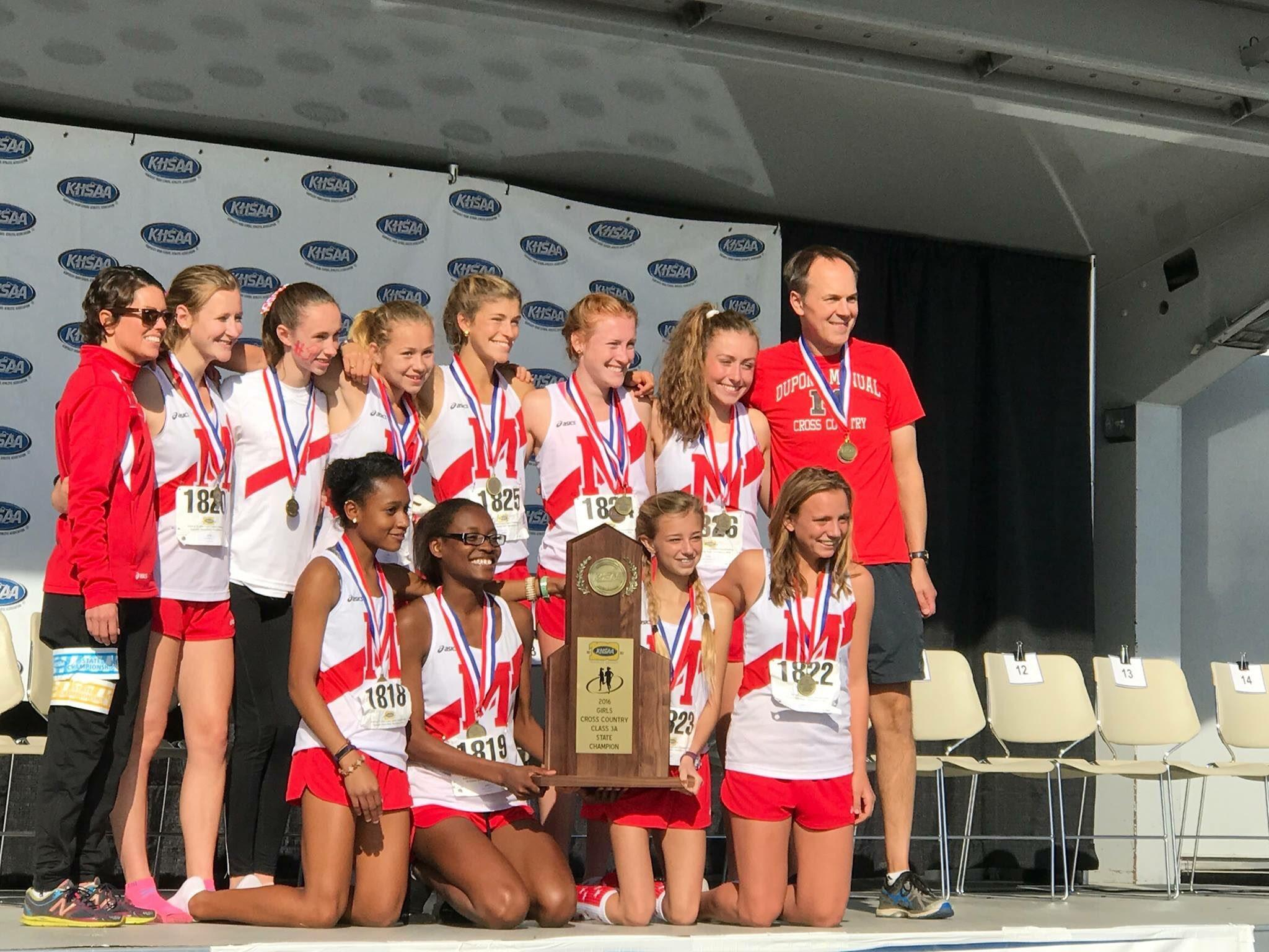 The girls' cross country team poses with the first place trophy at the state competition. Photo courtesy of Alena Sapienza-Wright.