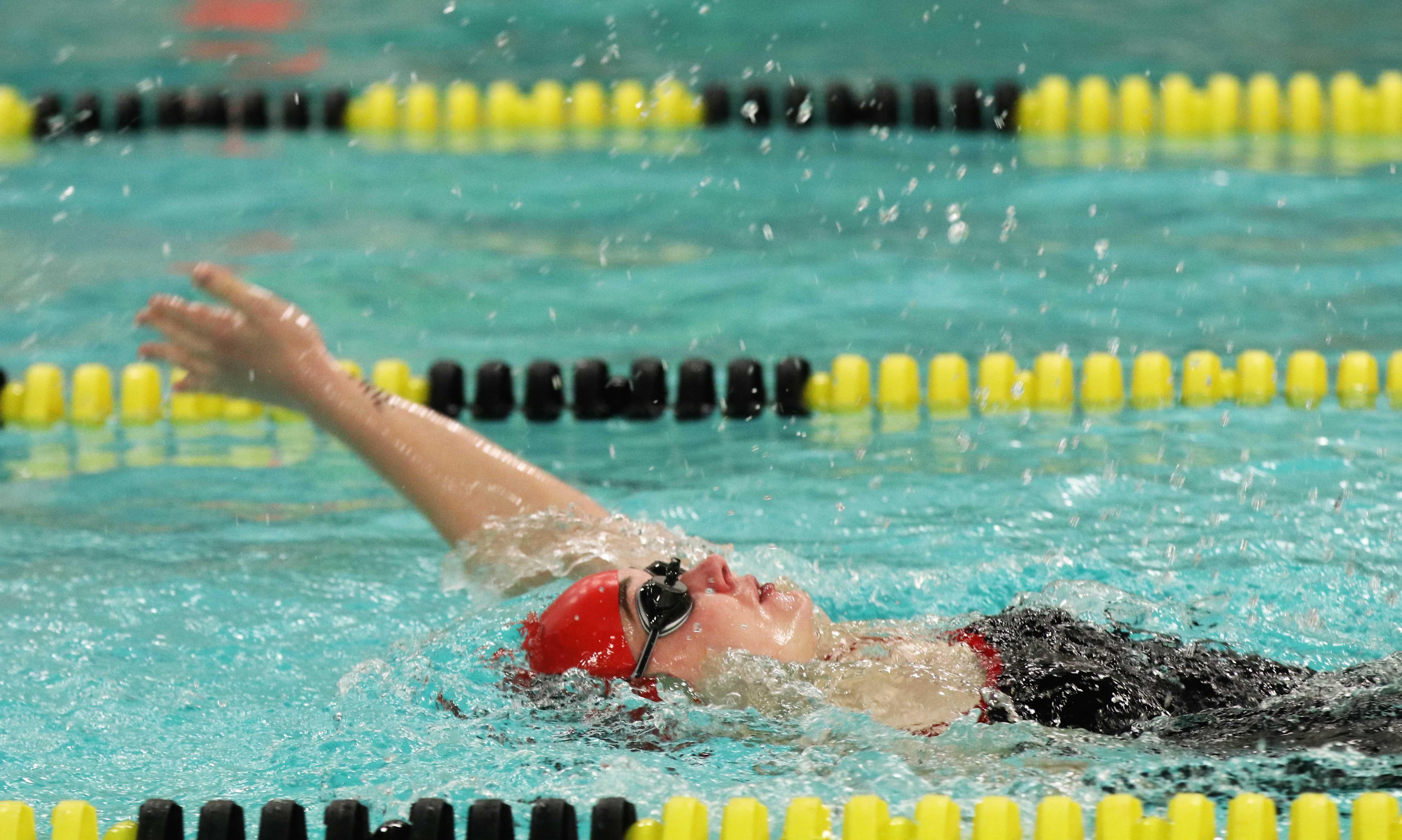 Caroline Henry (11, HSU) swims the backstroke with ease. Photo by Grace Bradley.