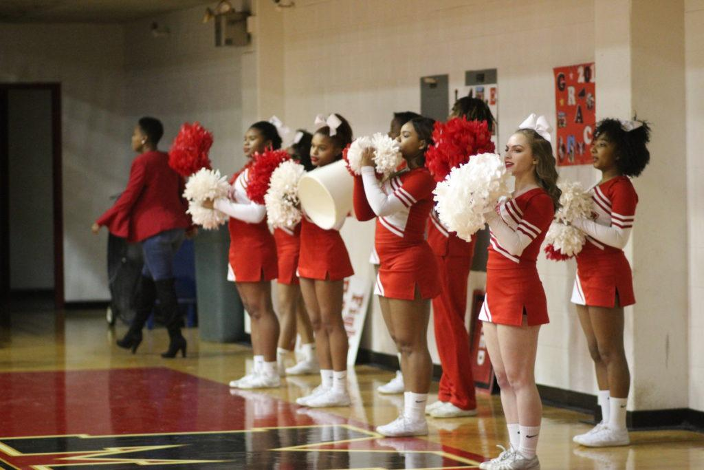 Cheerleaders+cheering+on+the+girls+basketball+game.+Photo+by+Cicada+Hoyt