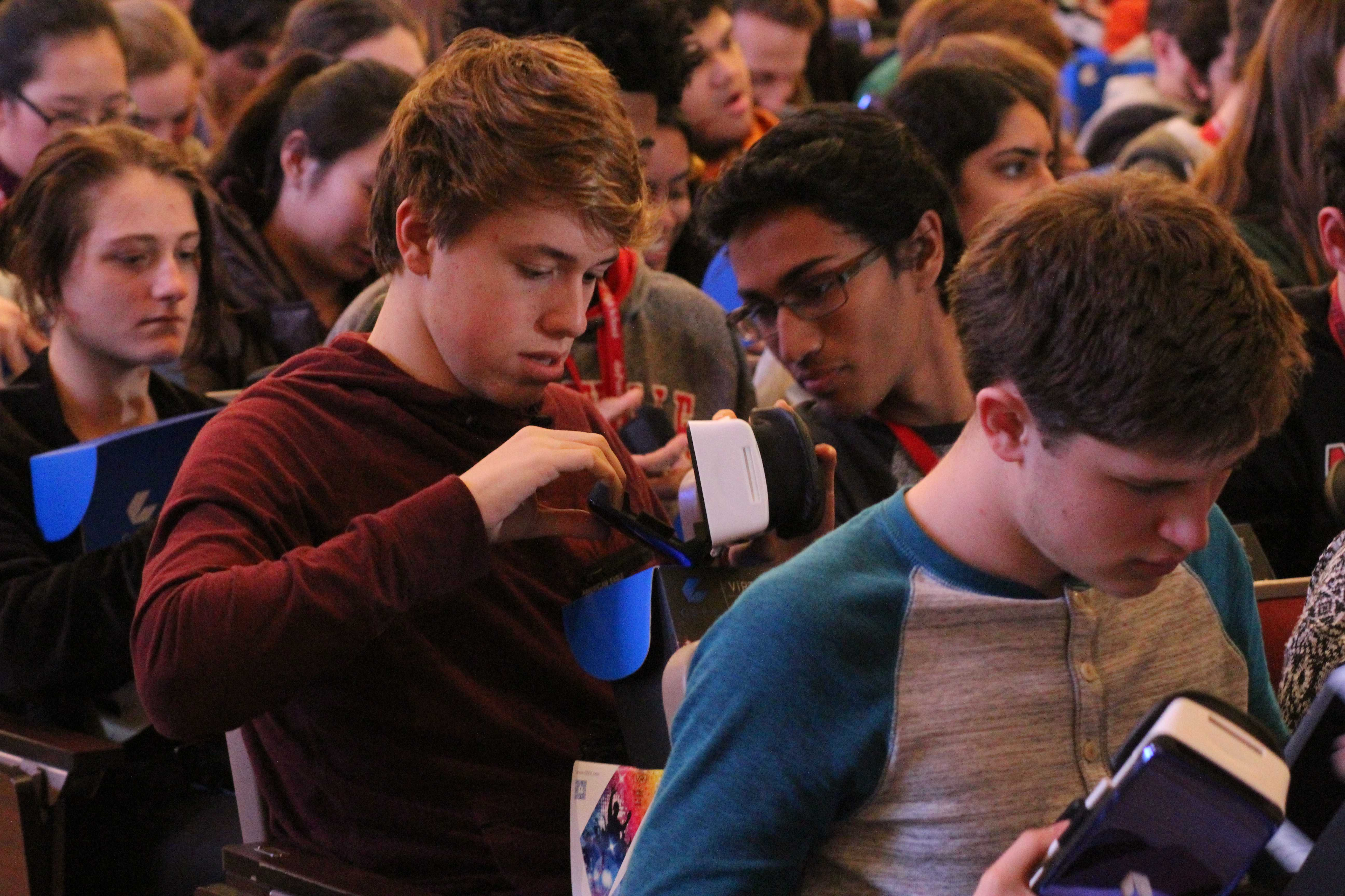 Student opening up new virtual reality headset. Photo by Cicada Hoyt