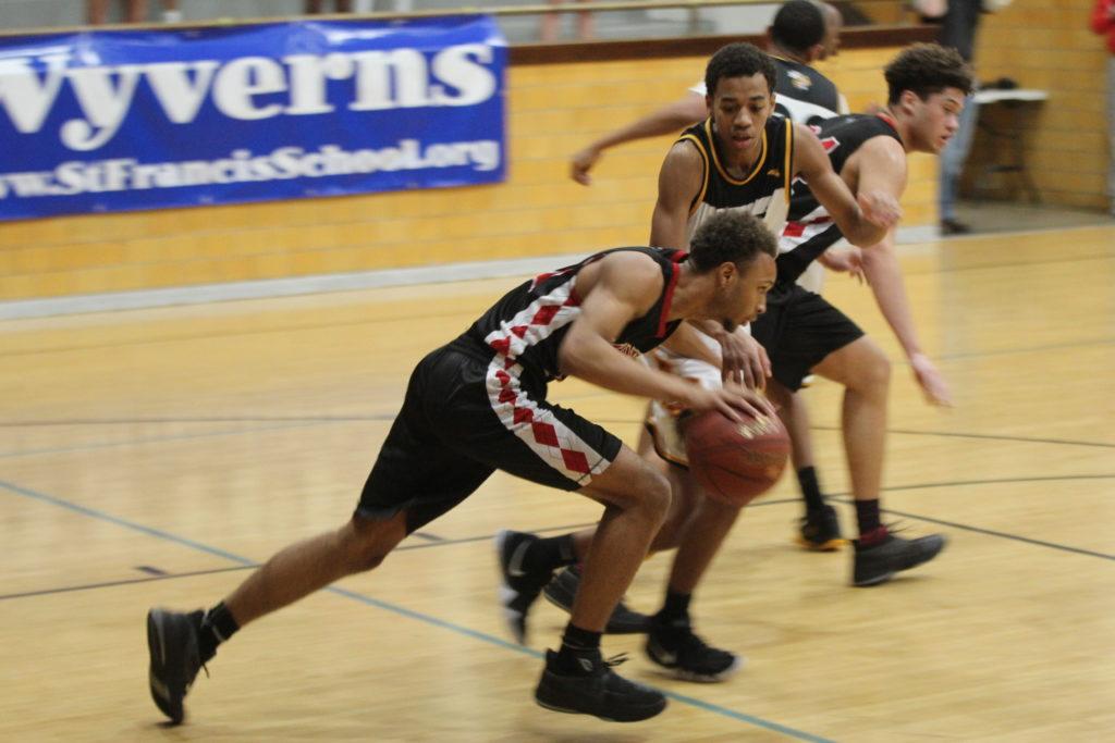 Jordan+McClendon+%2821%2C12%29+taking+the+ball+down+court.+Photo+by+Cicada+Hoyt