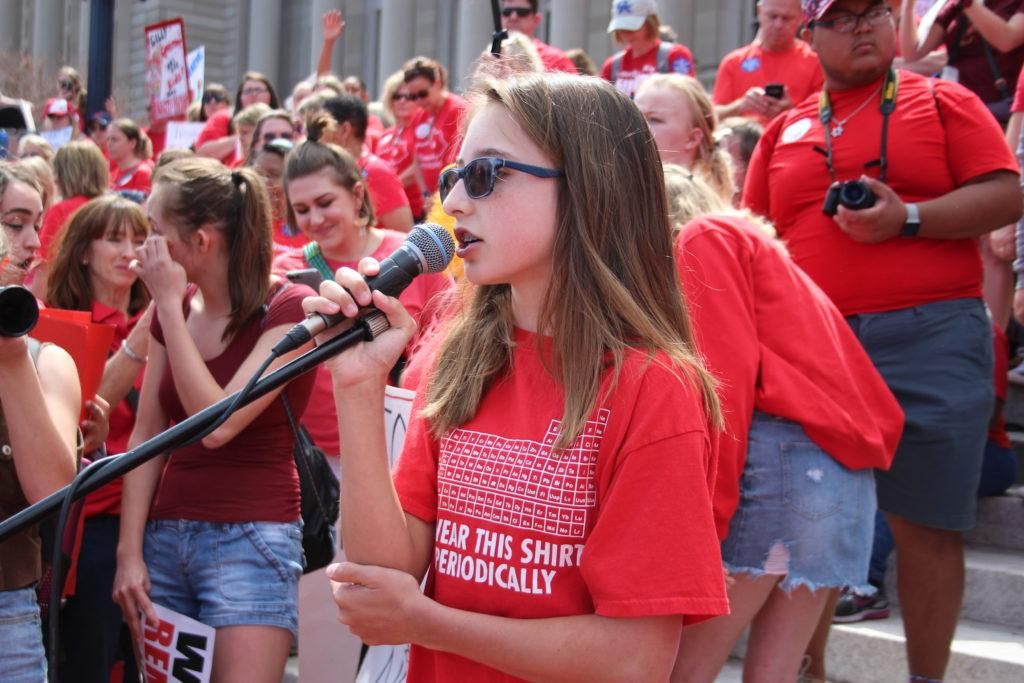 A 7th grader from Meyzeek Middle School speaking to the crowd. Photo by Jade Broderick.