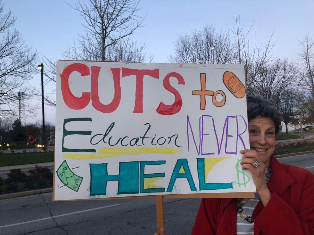 Hundreds+participated+in+the+early+morning+walk-in+protest+on+the+sidewalk+outside+the+school.
