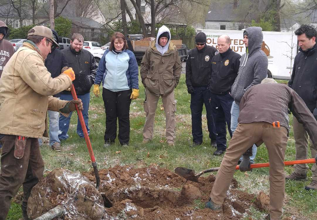 LMPD joins together with volunteers to help plant trees around the Churchill Downs area to make the city look better before Derby. Photo courtesy of @KYDerbyFestival on Twitter.