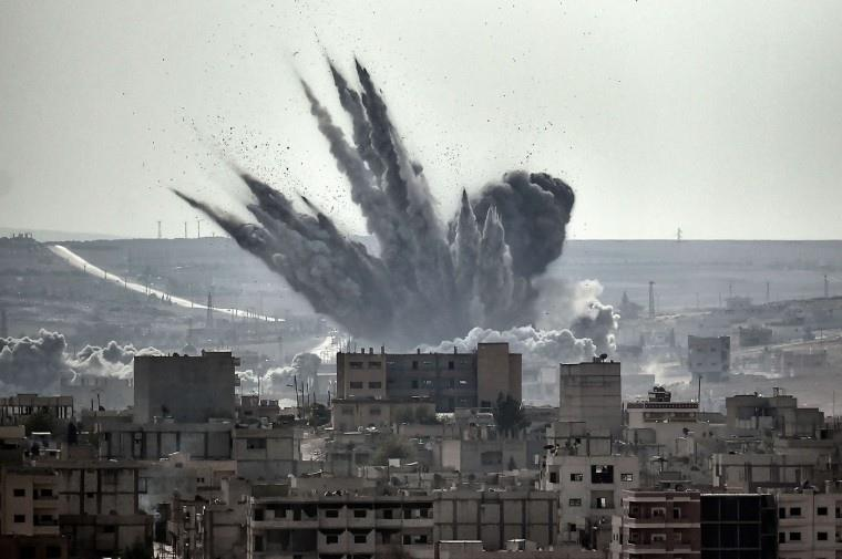 Shell exploding in the city of Kobane.