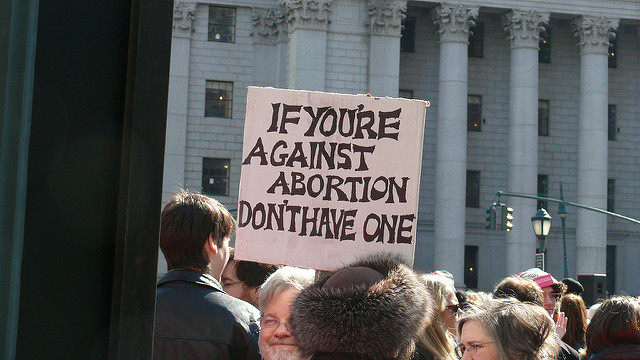 Image of a Pro-Choice protest sign. Photo by Chorlotte Cooper on Flickr, licensed under CC BY 2.0. No changes were made to the original image. Use of this image does not indicate photographer endorsement of this article. Image link: https://www.flickr.com/photos/cecooper/5479764357