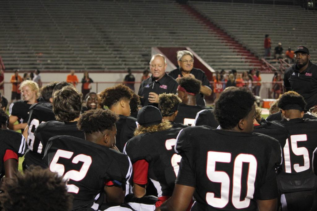 "Manual head coach, Scott Carmony, talks to the team after the game. ""After a game like this, we're feeling really good,"" Carmony said. Photo by EP Presnell."