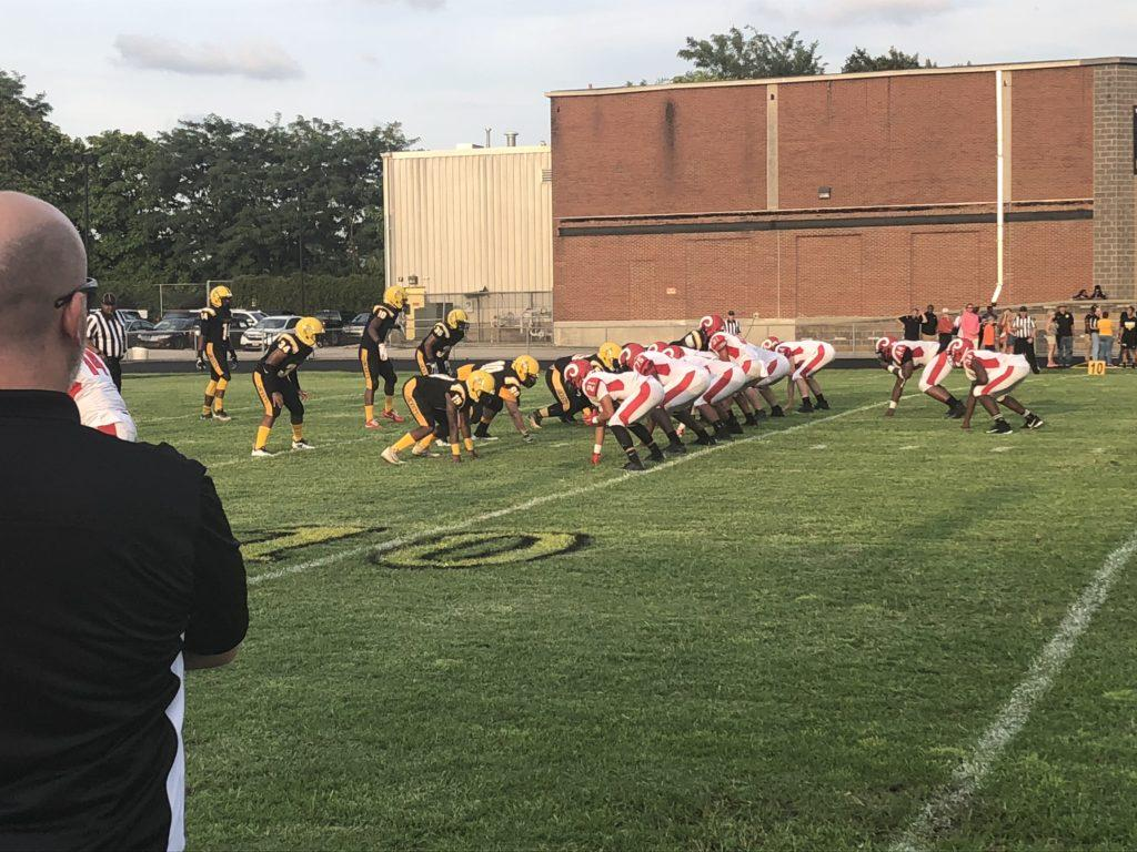 The Yellowjackets are about to attempt a pass with the Crimsons hoping to block it. Photo by Reece Gunther.