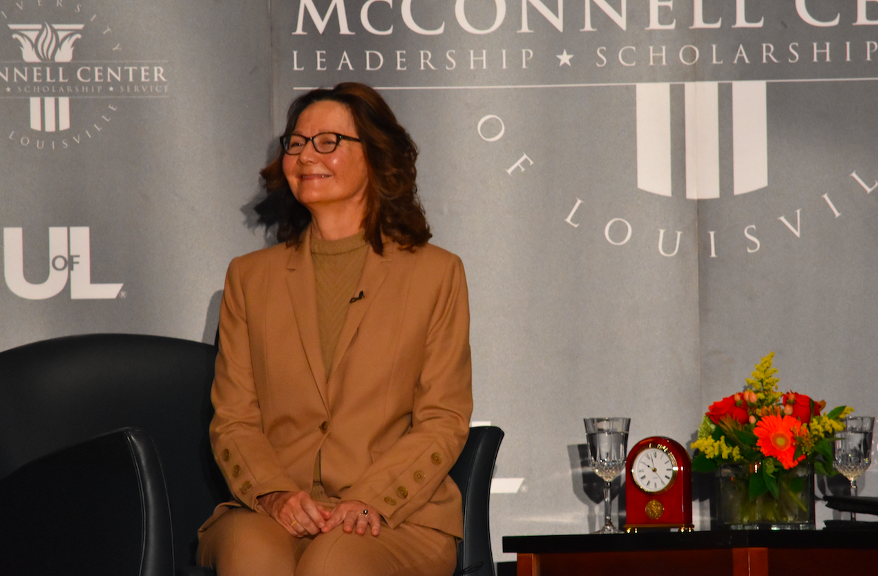 Gina Haspel smiles at an enthusiastic and applauding crowd as she joins Mitch McConnell and Scott Jennings on the stage. Photo by Piper Hansen.