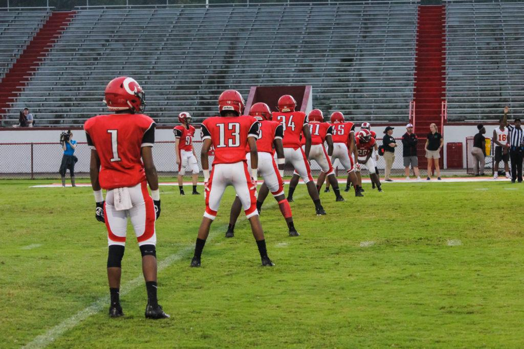 Crimsons+line+up+for+the+opening+kickoff+as+the+game+begins.+Photo+by+EP+Presnell.