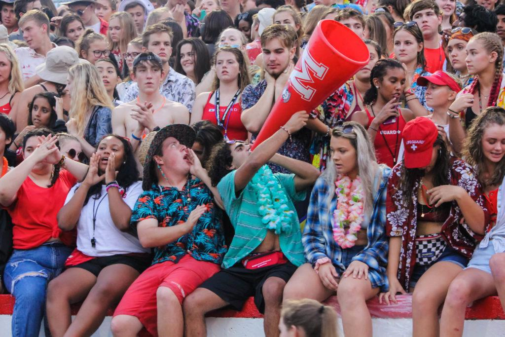Seniors at the head of the student crowd cheer on the team as Manual continues to score another touchdown. Photo by EP Presnell.