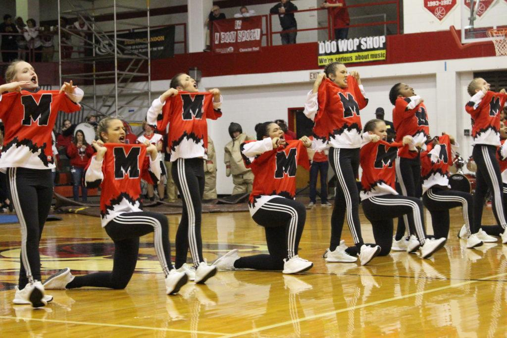The Dazzlers showing off their gear to the crowd. Photo by Payton Carns