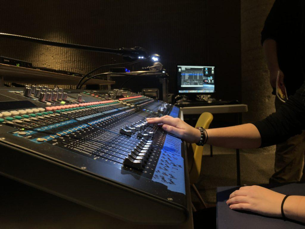 Abby Nash (11, YPAS) works alongside Kelsey Broyles (12, YPAS) as the Assistant Sound Technician. Photo by Cesca Campisano