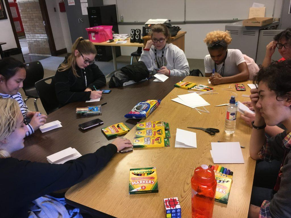 Students at Manual's RAMdom acts of kindness club make cards for women in rehab. Photo by Adrienne Sato