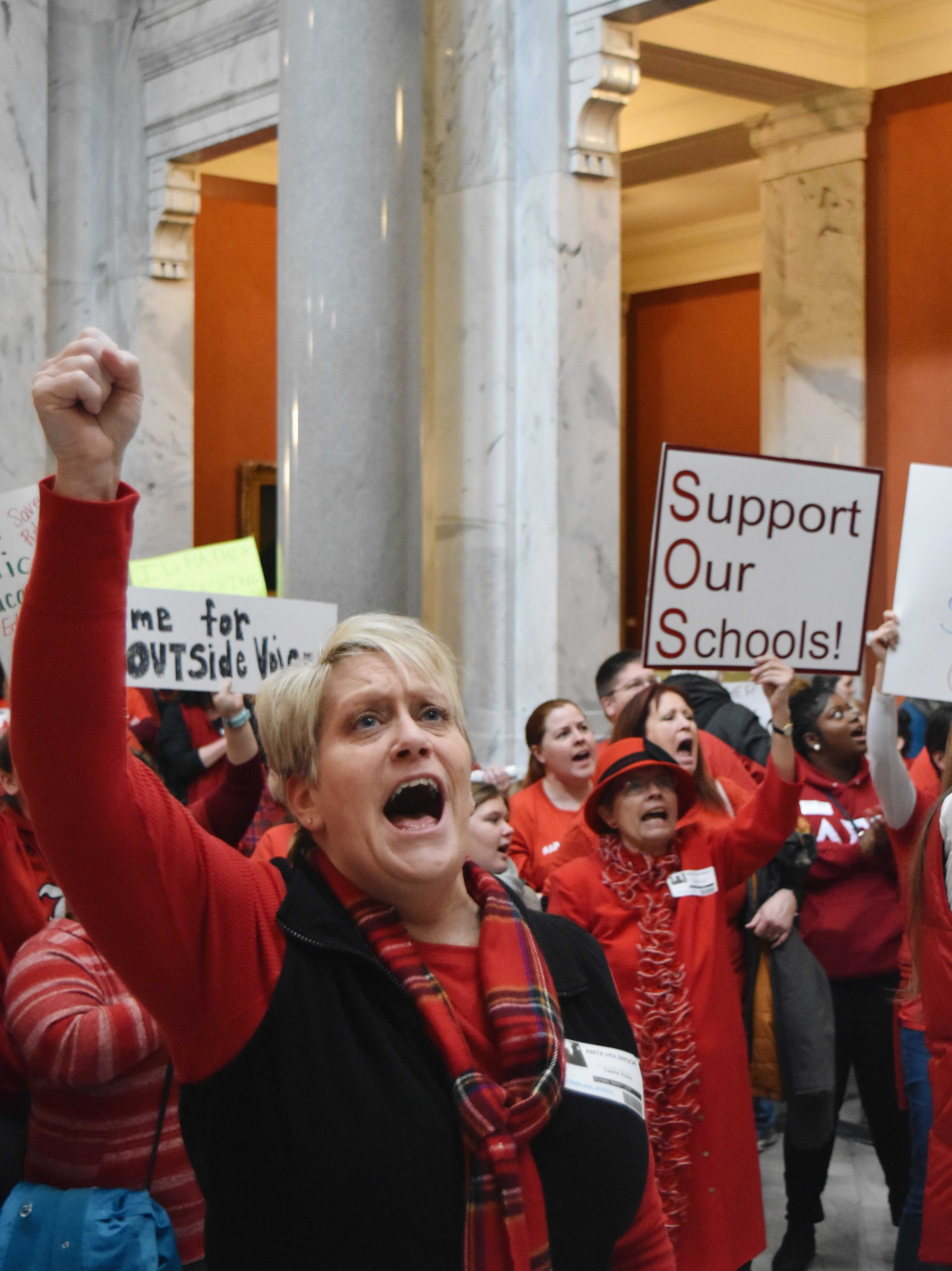 As+Democratic+legislators+walk+up+the+stairs+to+the+floor+of+the+House%2C+teachers+chant+as+loud+as+they+can+and+thank+them+for+their+support.+Photo+by+Piper+Hansen.