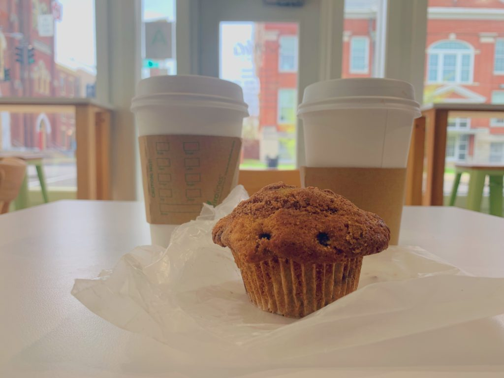 A blueberry streusel muffin accompanied by two coffees. Photo by Payton Carns.