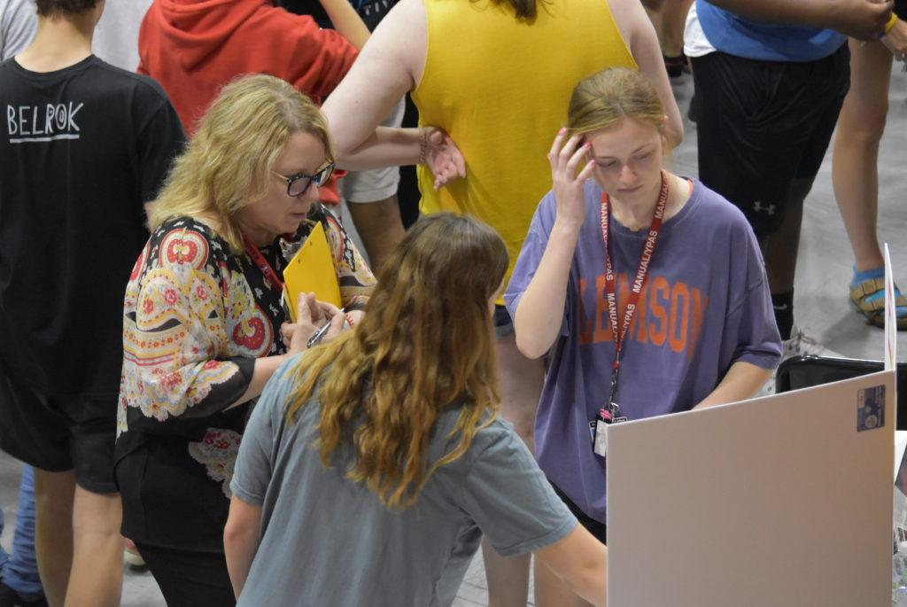 Ms. Ana Castro (Spanish) required her students to present countries that speak Spanish at the Multucultural Fair. Brooke Bollinger (12, MST) and Cora Kirby (12, J&C) explain their research process and what they learned. Photo by Piper Hansen.
