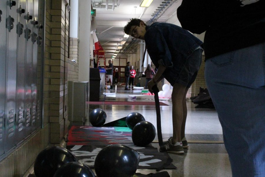 Patrick Harper (12, J&C) rolls out streamers along the junior class's hallway.