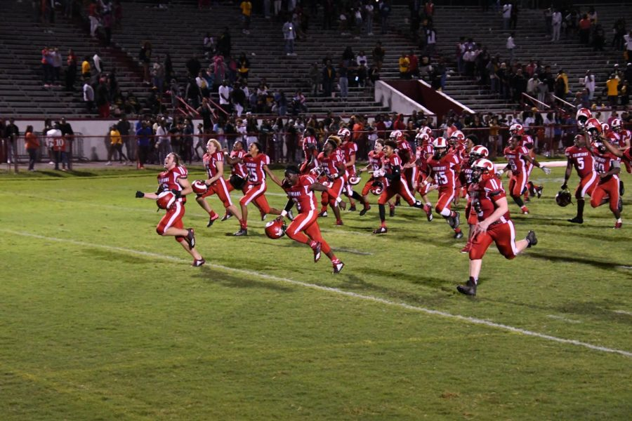 Manual's varsity football team runs to the end zone after winning 7-0 against Central a few weeks ago. Photo by Pieper Mallett