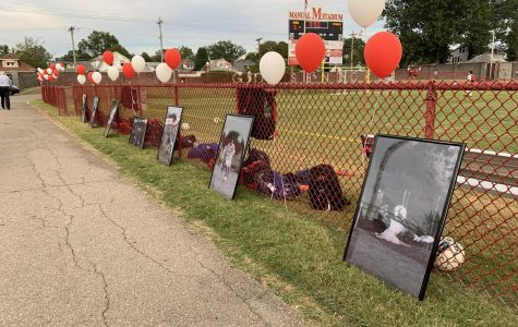 Senior night pictures and balloons all around duPont Manual stadium. Picture taken by Kate Hulette.