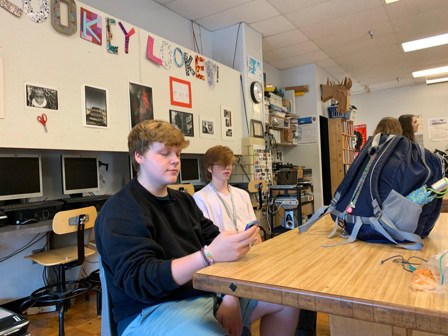 Students work on assignments on personal cell phones. Photo by Zoe Paige