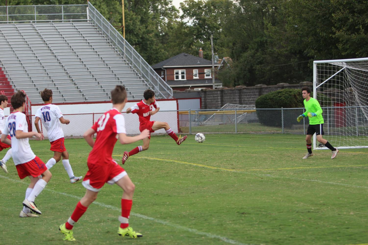 Forward Niko Sapienza leaps into a shot that would turn into a goal for Manual. Photo by Euan Dunn.