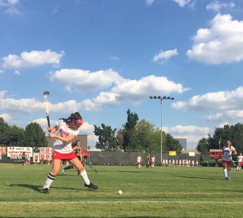 IMG_6912.JPG  One of the team captains of Manual's freshman field hockey team, Macy Carmony gears up to hit the ball back into play. Photo by Ella Dye.