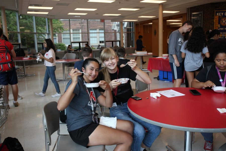 Camella Korner (10, MST) and Ella Waigel (10, YPAS) eat ice cream in the senior cafeteria as some of the first participants to arrive at the event. Photo by Jaesylin Stephens.