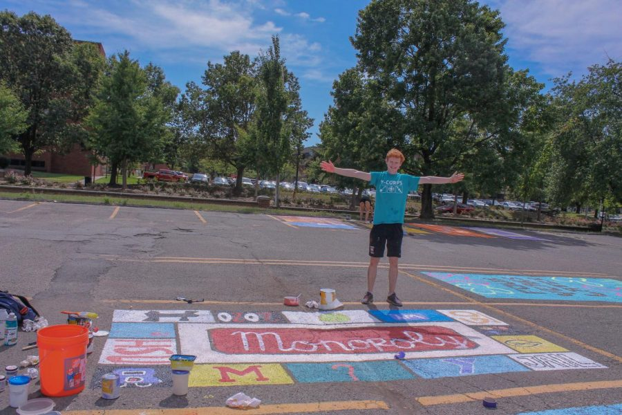Aidan Sheridan-Rabideau (12, HSU) poses with his completed, Monopoly-themed, parking space.
