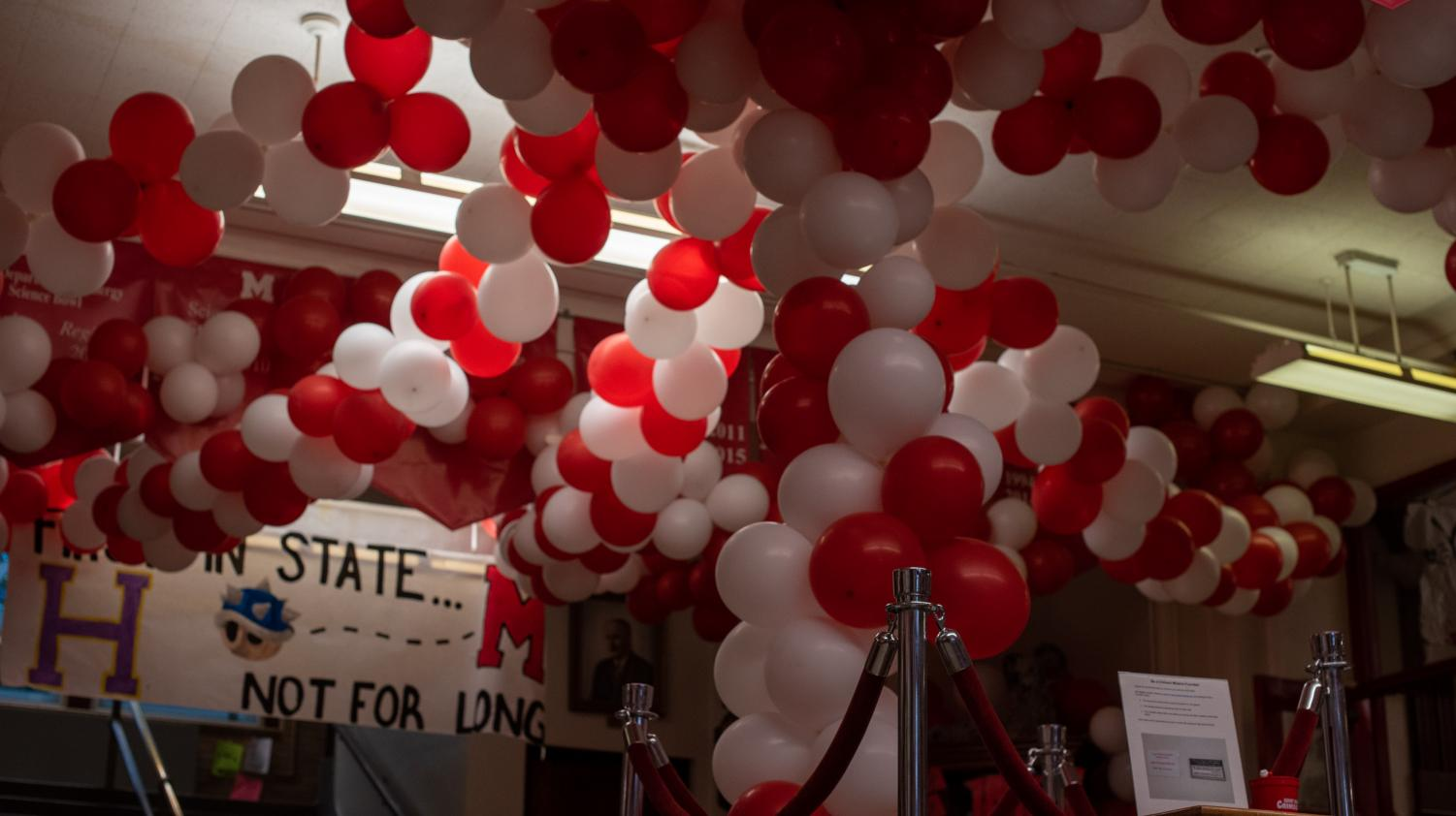 In center hall, the balloons come to hang down in the roped area at the front of the school. Photo by Cesca Campisano