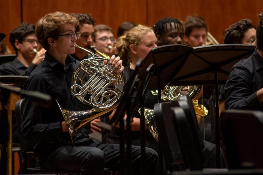 Matthew Schmidt (10, YPAS) plays the French horn with the brass section of the band. Photo by Cesca Campisano