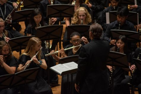 Mr. Jason Gregory acts as the conductor to the YPAS band as they perform in the Prism Concert. Photo by Cesca Campisano