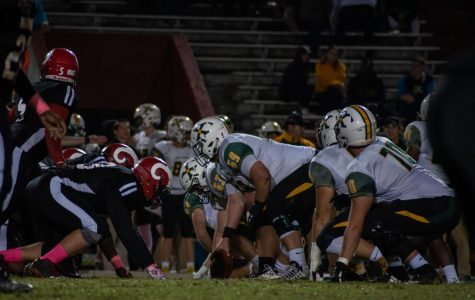St. X prepares to snap the ball to the quarterback to start the play. Photo by Cesca Campisano.
