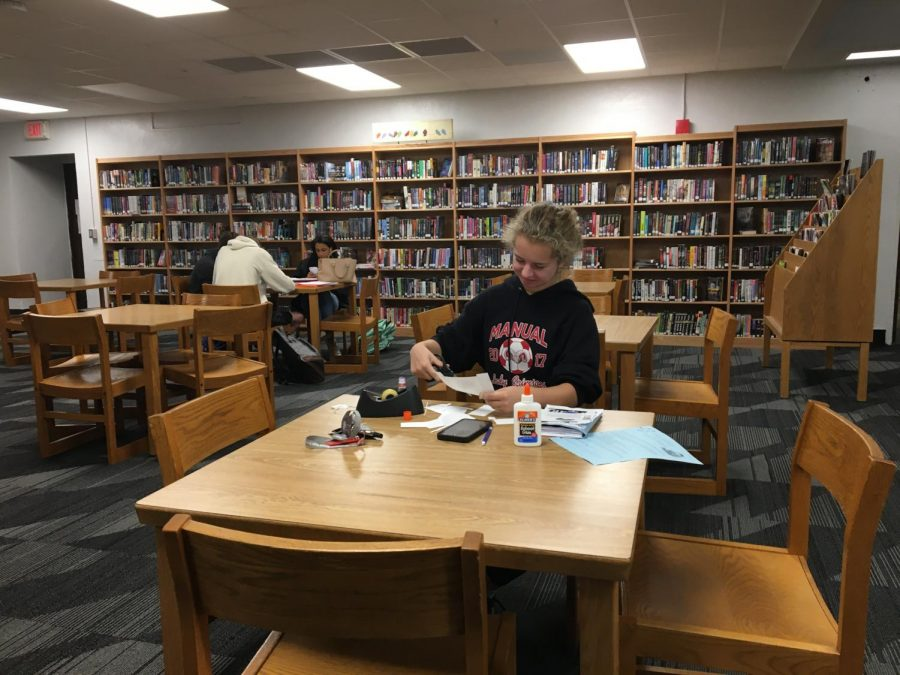 Julia Werner (12, HSU) works on schoolwork in the library during her study skills. Photo taken by Mandala Gupta VerWiebe before school was canceled due to COVID-19.