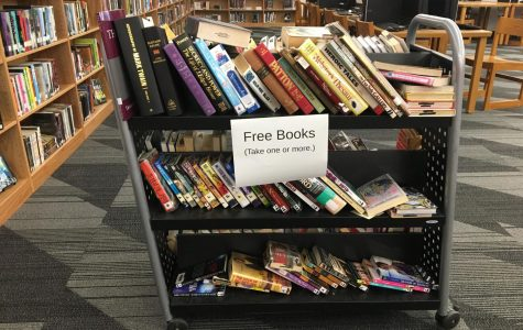 A cart full of free books that the librarians were offering to students. Photo by Mandala Gupta VerWiebe