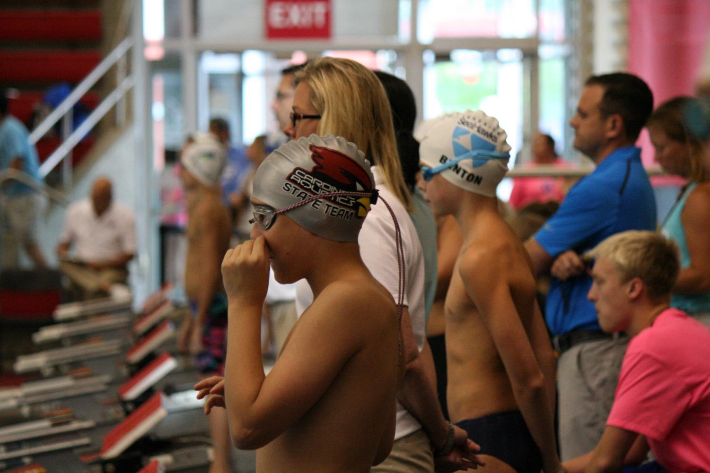 A Cardinal Aquatics swimmer prepares for a race at U of L. Photo by Kate Benton.