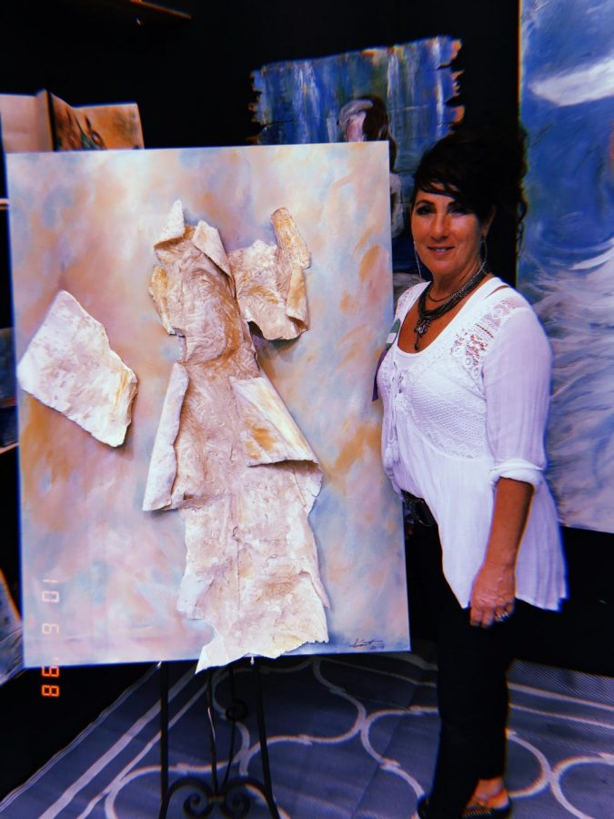 Kristina+Crocifissa+with+her+artwork.++%E2%80%9CThe+world+is+full+of+art%2C+and+anyone+who+says+an+artists+can%E2%80%99t+make+money%2C+you+have+to+want+to+do+it.+You+have+to+want+it+like+your+breath%2C%E2%80%9D+Crocifissa+said.++Photo+by+Caliyah+Smith