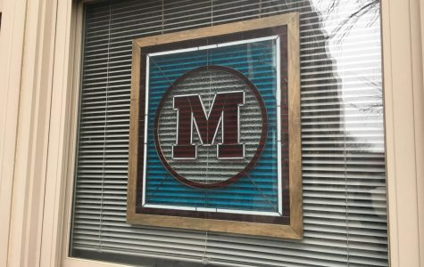 Stained glass outside of the principal's office representing
