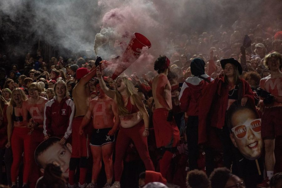 The student section goes wild as the Crimsons score their first touchdown of the night. Photo by Cesca Campisano