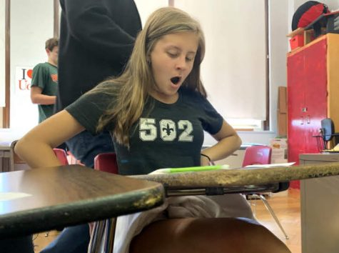 A student yawns during a normal day of classwork early in first block as they prepare to pack-up before heading to second block.