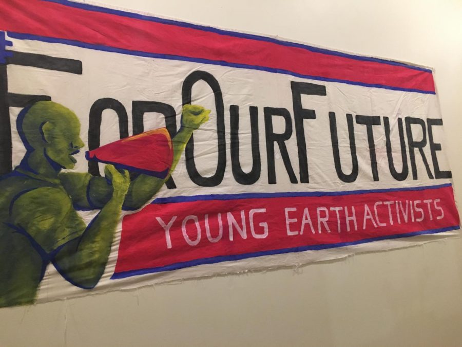 An unnamed artist created the banner hung up in the Healthy House hallway, amongst the other artwork. The painted cloth signifies youth empowerment. Photo taken by Isabella Bonilla