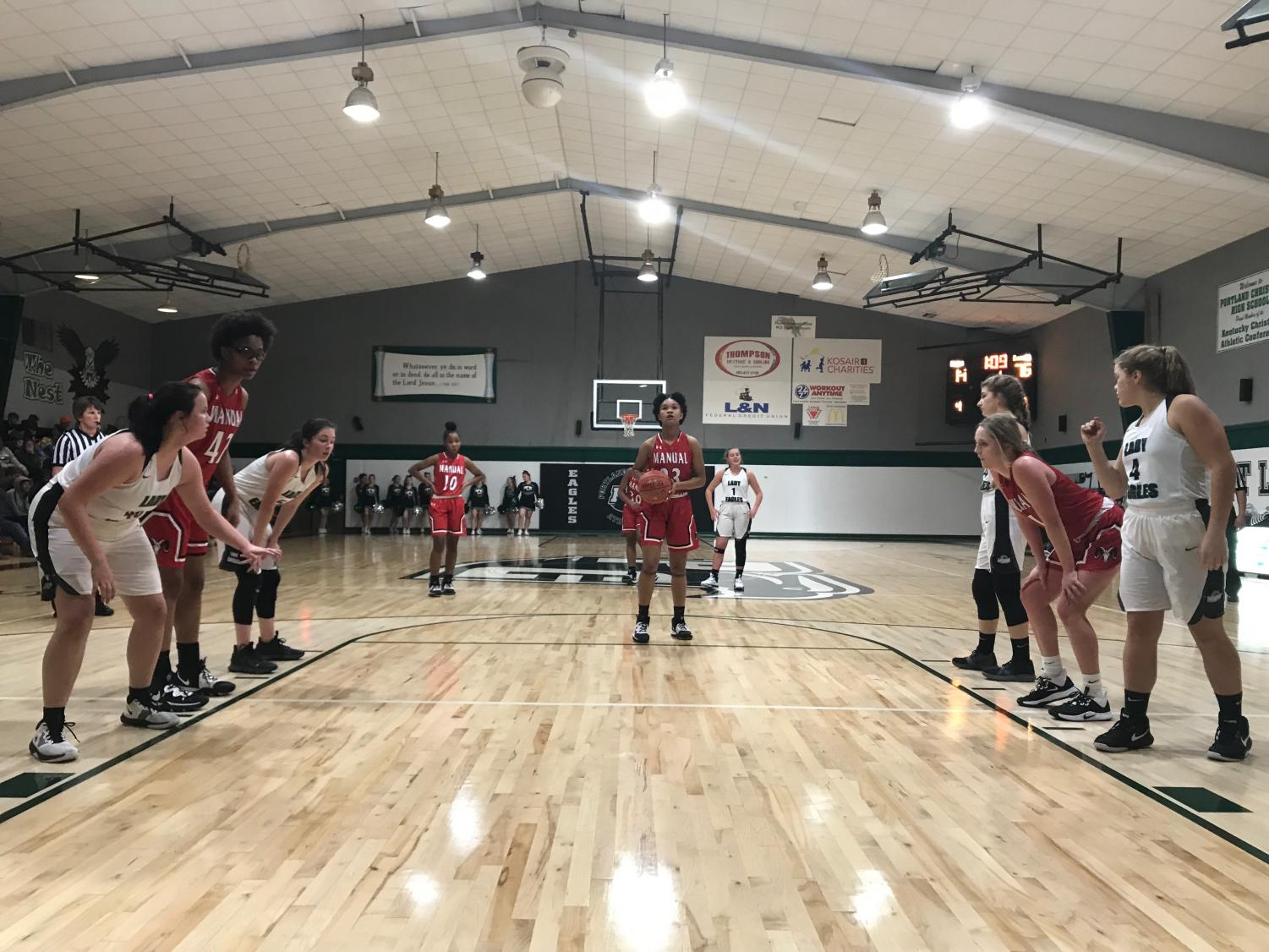 Payton Bush (9, #23) sets up for a free throw before making both shots. Photo courtesy of Karlie Brockman.
