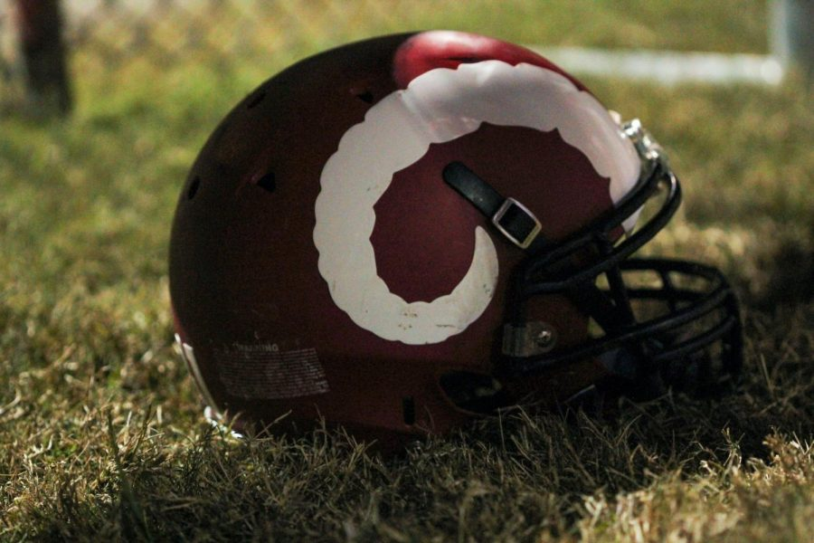 At the 2019 Male, Manual game, a helmet sits alone as Male dominates Manuals offense and defense following a back-to-back matchup.