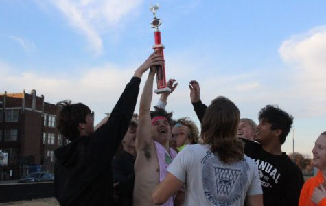 Team Ween raises their trophy in the air after winning the Crimsons Against Cancer kickball tournament. Photo by Morgan David.