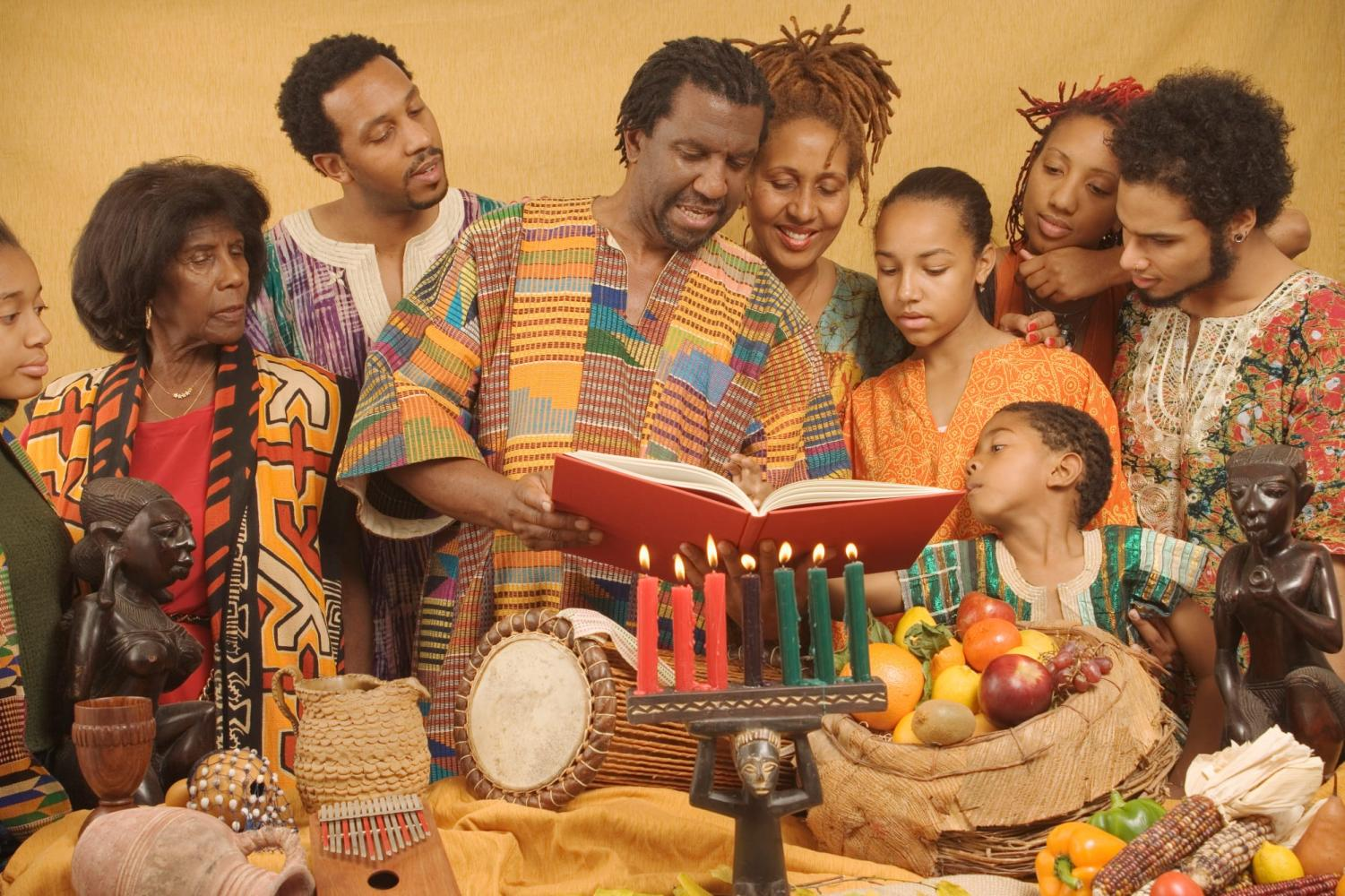 A family celebrates Kwanzaa by reading the scripture together.